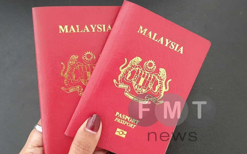 an australian news report says syndicates are smuggling people into australia by obtaining visas using malaysian passports